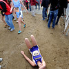 "Emma Merryman, of Boulder High, collapses on the ground after finishing in the 5A  girls race.<br /> For more photos of state, go to  <a href=""http://www.dailycamera.com"">http://www.dailycamera.com</a>.<br /> Cliff Grassmick / October 29, 2011"