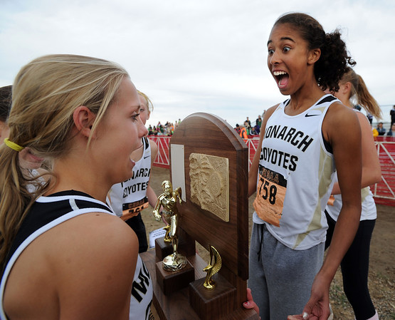 "Kaitlyn Benner, left, and Claire Green, both of Monarch High, apparently can't believe they just won the 5A Colorado State Championship.<br /> For more photos of state, go to  <a href=""http://www.dailycamera.com"">http://www.dailycamera.com</a>.<br /> Cliff Grassmick / October 29, 2011"