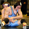 """Boulder High School wrestler Lance Padilla, left, looks at the clock while wrestling Mountain Range's Jordan Taylor in the third place match for 125-pound class during the Front Range League Wrestling Tournament on Saturday, Jan. 29, at Fossil Ridge High School in Fort Collins. For more photos go to  <a href=""""http://www.dailycamera.com"""">http://www.dailycamera.com</a><br /> Photo by Jeremy Papasso"""