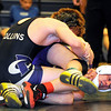 """Boulder High School wrestler Connor Murtha, right, struggles to get free from Fort Collins wrestler Adam Barela in the championship match for the 130-pound weight class during the Front Range League Wrestling Tournament on Saturday, Jan. 29, at Fossil Ridge High School in Fort Collins. Murtha lost the match. For more photos go to  <a href=""""http://www.dailycamera.com"""">http://www.dailycamera.com</a><br /> Photo by Jeremy Papasso"""