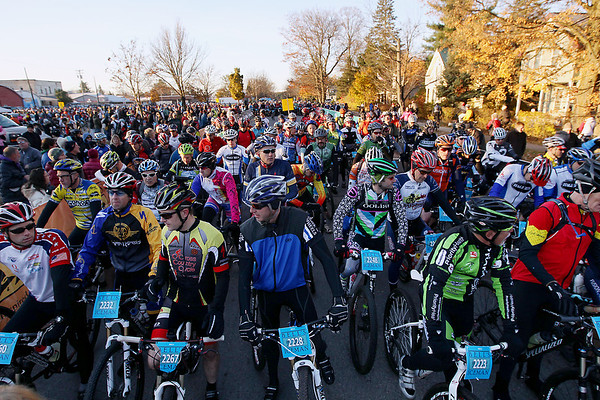 Record-Eagle/Keith King<br /> Riders gather at the starting line on South Walnut Street in Kalkaska Saturday, November 5, 2011 as they prepare to compete in the 22nd annual Iceman Cometh.