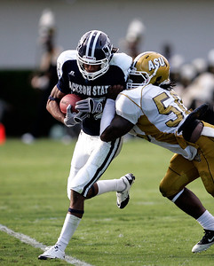 Jackson State receiver Rico Richardson is pushed out of bounds by an Alabama State defender.