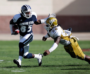 Jackson State receiver Marcellos Wilder attempts to stiff arm an Alabama State defender.