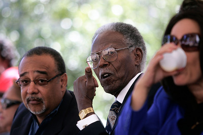 """Jackson State President Emeritus Dr. John A. Peoples watches closely as the """"Sonic Boom"""" marching bands makes their way up Capital St."""