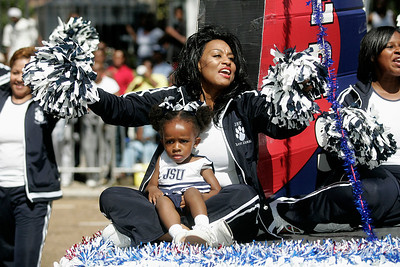 Jackson State alumni cheerleader yells out a cheer as her float moves past the parade grand stand.