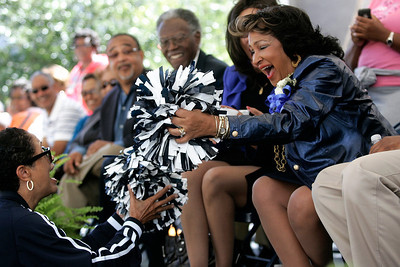 Jackson State University President Dr. Carolyn Meyers is presented a set of poms poms from the alumni association cheerleader squad during the annual homecoming parade.