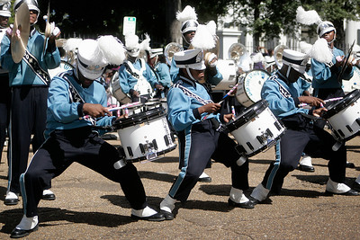 "Members of the JSU ""Sonic Boom"" drumline breakdown during a rendition of the ""The Show"" by old school hip hop artist Doug E. Fresh."