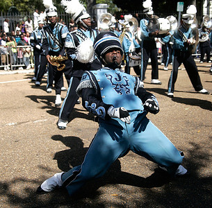 "Jackson State University ""Sonic Boom of the South"" drum major dances during  a short performance in the front of the homecoming parade grand stand."