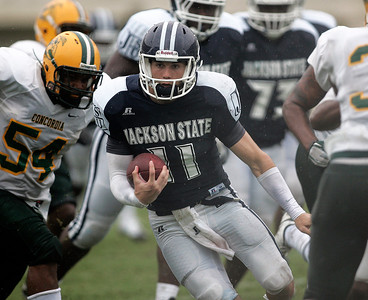 Jackson State quarterback Casey Therriault runs past Concodia defenders.