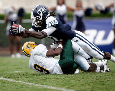 Jackson State receiver E. J. Drewery dives for the end zone during the first half of play against Concordia College.