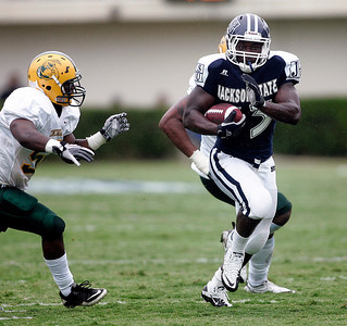 Jackson State running back Michael Bolden scampers past a couple of Concordia defenders.