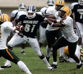 Jackson State receiver Renty Rollins  attempts to push away a Concordia defender.
