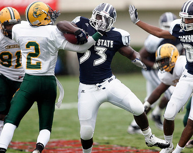 Jackson State running back Michael Bolden attempts to run past a Concordia defender.