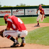"""Fairview's Jake Olsen, left, shows his disappointment as Cale O'Donnell rounds the bases after hitting a three-run homer on Sunday, July 31, during the Colorado State Legion A Championship game at Fairview High School in Boulder. Rocky Mountain Lobos defeated Fairview 12-6. For more photos of the game go to  <a href=""""http://www.dailycamera.com"""">http://www.dailycamera.com</a><br /> Jeremy Papasso/ Camera"""
