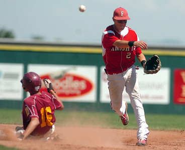 Fairview's Travis Scavo makes a double play on Sunday, July 31, during the Colorado State Legion A Championship game against The Rocky Mountain Lobos at Fairview High School in Boulder. Rocky Mountain Lobos defeated Fairview 12-6. For more photos of the game go to www.dailycamera.com Jeremy Papasso/ Camera