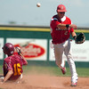 "Fairview's Travis Scavo makes a double play on Sunday, July 31, during the Colorado State Legion A Championship game against The Rocky Mountain Lobos at Fairview High School in Boulder. Rocky Mountain Lobos defeated Fairview 12-6. For more photos of the game go to  <a href=""http://www.dailycamera.com"">http://www.dailycamera.com</a><br /> Jeremy Papasso/ Camera"