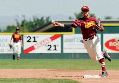 Rocky Mountain's Nick Komar makes a play at first base on Sunday, July 31, during the Colorado State Legion A Championship game against Fairview at Fairview High School in Boulder. Rocky Mountain Lobos defeated Fairview 12-6. For more photos of the game go to www.dailycamera.com Jeremy Papasso/ Camera