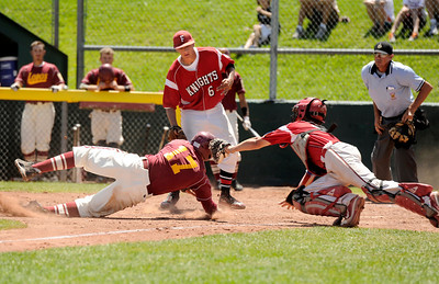 Rocky Mountain's Marcus Bean slides into home plate safely under the tag of Fairview catcher Evan Thoning on Sunday, July 31, during the Colorado State Legion A Championship game at Fairview High School in Boulder. Rocky Mountain Lobos defeated Fairview 12-6. For more photos of the game go to www.dailycamera.com Jeremy Papasso/ Camera