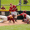 "Rocky Mountain's Marcus Bean slides into home plate safely under the tag of Fairview catcher Evan Thoning on Sunday, July 31, during the Colorado State Legion A Championship game at Fairview High School in Boulder. Rocky Mountain Lobos defeated Fairview 12-6. For more photos of the game go to  <a href=""http://www.dailycamera.com"">http://www.dailycamera.com</a><br /> Jeremy Papasso/ Camera"