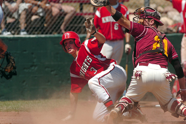 """Fairview's Cameron Frazier is tagged out at home plate by Rocky Mountain catcher Tyler Weins on Sunday, July 31, during the Colorado State Legion A Championship game at Fairview High School in Boulder. Rocky Mountain Lobos defeated Fairview 12-6. For more photos of the game go to  <a href=""""http://www.dailycamera.com"""">http://www.dailycamera.com</a><br /> Jeremy Papasso/ Camera"""