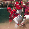 "Fairview's Cameron Frazier is tagged out at home plate by Rocky Mountain catcher Tyler Weins on Sunday, July 31, during the Colorado State Legion A Championship game at Fairview High School in Boulder. Rocky Mountain Lobos defeated Fairview 12-6. For more photos of the game go to  <a href=""http://www.dailycamera.com"">http://www.dailycamera.com</a><br /> Jeremy Papasso/ Camera"
