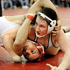 Broomfield High School wrestler Nick Babcock, right, tries to pin Denver East wrestler Derrick Christopher in a 140-pound concellation match at the Top Of The Rockies wrestling meet on Saturday, Jan. 22, at Centaurus High School in Lafayette. Babcock defeated Christopher 7-4 after three periods.<br /> Photo by Jeremy Papasso