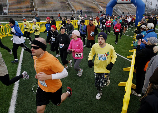 Record-Eagle/Keith King<br /> Participants start Thursday, November 24, 2011 during the fourth annual Traverse City Turkey Trot.