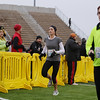 Record-Eagle/Keith King<br /> Jami Rodes runs toward the finish line at Thirlby Field Thursday, November 24, 2011 during the fourth annual Traverse City Turkey Trot.