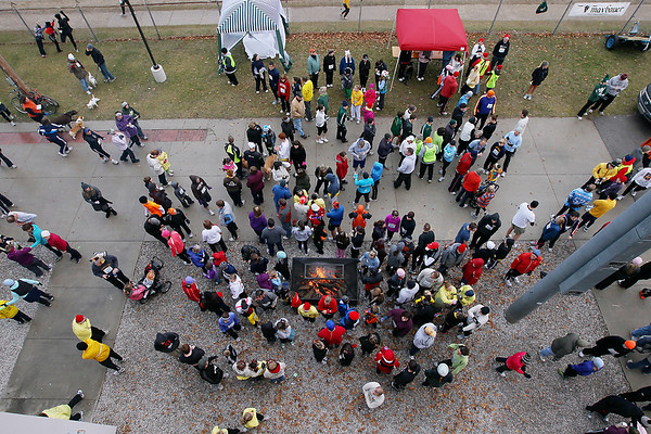 Record-Eagle/Keith King<br /> Participants as well as others gather at Harry T. Running Stadium Thursday, November 24, 2011 prior to the start of the fourth annual Traverse City Turkey Trot.
