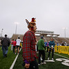 Record-Eagle/Keith King<br /> Bruce McHaney walks near the finish line after he finished the fourth annual Traverse City Turkey Trot Thursday, November 24, 2011 at Thirlby Field.