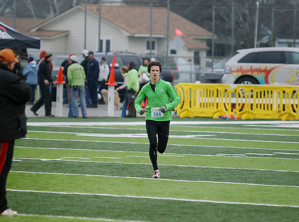 Record-Eagle/Keith King<br /> Ian Connick runs toward the finish line Thursday, November 24, 2011 during the fourth annual Traverse City Turkey Trot.
