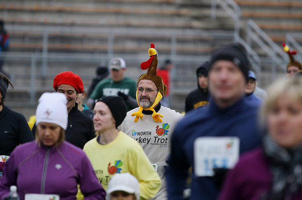 Record-Eagle/Keith King<br /> John Marlin, wearing a turkey hat, starts the fourth annual Traverse City Turkey Trot Thursday, November 24, 2011 at Thirlby Field.