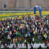 Record-Eagle/Keith King<br /> Participants wait to hear the National Anthem at Thirlby Field Thursday, November 24, 2011 prior to the start of the fourth annual Traverse City Turkey Trot.