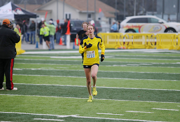 Record-Eagle/Keith King<br /> Kaitlyn Patterson runs toward the finish line at Thirlby Field Thursday, November 24, 2011 during the fourth annual Traverse City Turkey Trot.