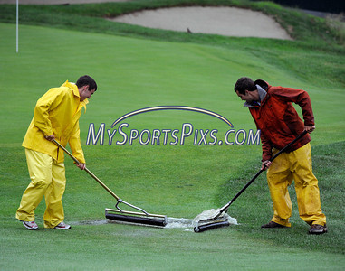 6/23/2011 Mike Orazzi | Staff Travelers grounds crew staff Sean Burns (left) and Steve Muhlberg sweep water from the fairway on the 17th hole during a rain delay at the 2011 Travelers Championship in  Cromwell, on Thursday, June 23, 2011.