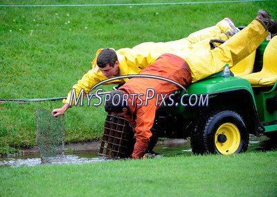 6/23/2011 Mike Orazzi | Staff Travelers grounds crew staff Sean Burns (left) and Steve Muhlberg clear a storm drain on the 17th hole during a rain delay at the 2011 Travelers Championship in  Cromwell, on Thursday, June 23, 2011.