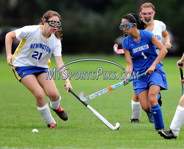9/20/2011 Mike Orazzzi | Staff Newington's Brittany Loco (21)  and Southington's Casey Sullivan (1) during Tuesday's field hockey match at NHS.