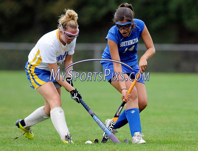 9/20/2011 Mike Orazzzi | Staff Newington's Vicky Richards (11) and Southington's Melissa Shuster (14) during Tuesday's field hockey match with Newington at NHS.