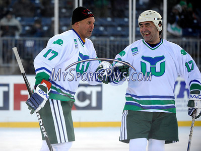 2/19/2011 Mike Orazzi | Staff Hartford Whalers alumni Wayne Babych (17) and Ray Neufeld (17) (not sure who is who, they both wear 17) celebrate a goal during Saturday evening's game with the Boston Bruins alumni at Rentschler Field in East Hartford.