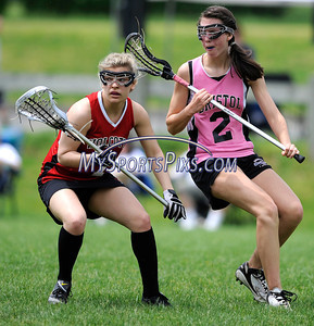 5/21/2011 Mike Orazzi | Staff Bristol Lacrosse's Hannah Lemek (2) and  Wolcott's Bianca D'Angelo (7) at Bristol Eastern High School on Saturday.