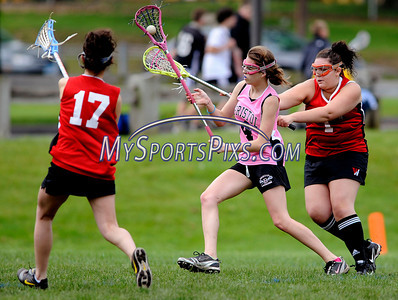 5/21/2011 Mike Orazzi | Staff Bristol Lacrosse's Gabby Sacharko (4) between Wolcott's Demi Diaz (17) and Bianca Guerrera (1) at Bristol Eastern High School on Saturday.
