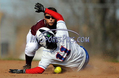 4/15/2011 Mike Orazzi | Staff Plainville's Cheyenne Daike (11) slides safely into second base as Bristol Central's Taylor Plantamuro waits for the ball during Friday's softball game at Bristol Central.