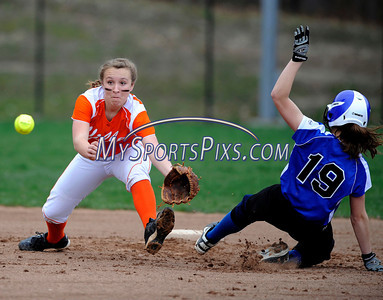 4/27/2011 Mike Orazzi | Staff Terryville's Anna Dupaul (15) reaches for the ball as Lewis Mills' Hope Shevchuk (19) steals second base at THS on Wednesday afternoon.