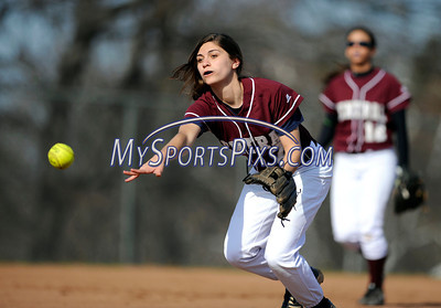 4/15/2011 Mike Orazzi | Staff Bristol Central's Ashley LaPenta (7) tosses a ground ball to first for an out during Friday's softball game with Plainville at Bristol Central.