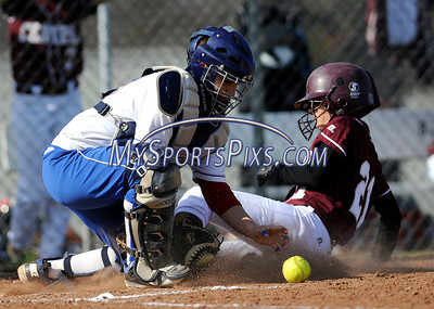 4/15/2011 Mike Orazzi | Staff Bristol Central's Ashley Rivera (21) slides safely into home as Plainville's Alexis Ruscito (22)during Friday's softball game with Plainville at Bristol Central.