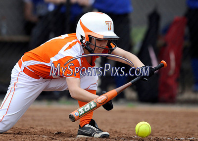 4/27/2011 Mike Orazzi | Staff Terryville's Marissa O'Loughlin (4) lays down a bunt at THS on Wednesday afternoon.