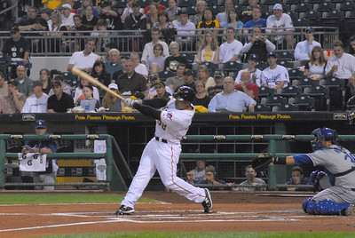 Xavier Paul of the Pittsburgh Pirates makes contact with the ball in a game against the Los Angeles Dodgers on 5/12/2011.