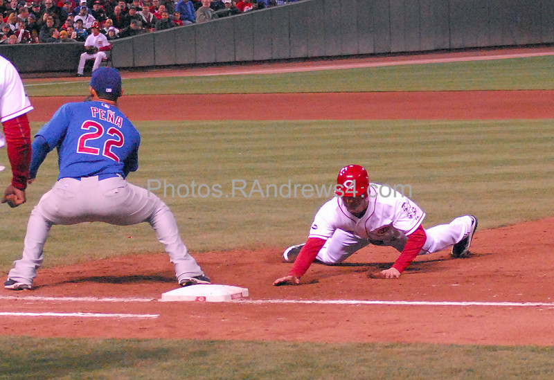 Drew Stubbs dives back to first base as Carlos Pena waits for the pick off attempt from Carlos Zambrano. Stubbs was safe in this game between the Chicago Cubs in Cincinnati on 5/16/2001.