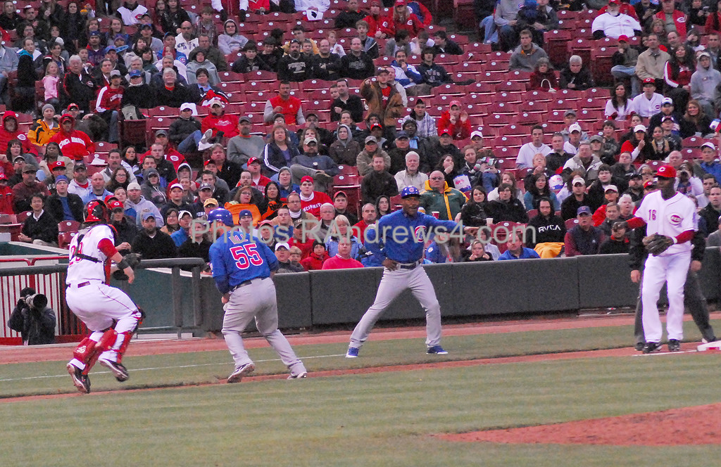 Chicago Cubs baserunner Koyle Hill (55) was running with the pitch and got caught in a rundown between Reds catcer Ryan Hanigan (29) and third baseman Edgar Renteria (16). 5/16/2011