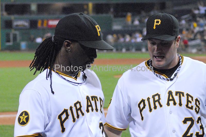 Pittsburgh Pirates center fielder Andrew McCutchen talks to right fielder Matt Diaz between innings.